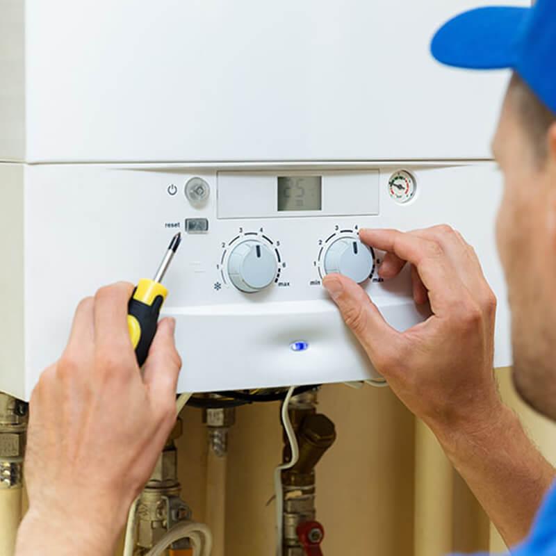 Man Completing Boiler Repair