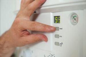 Person Adjusting Boiler System