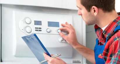Central Heating Engineer Carrying out Boiler Service