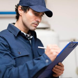 Engineer Completing Central Heating Maintenance Service